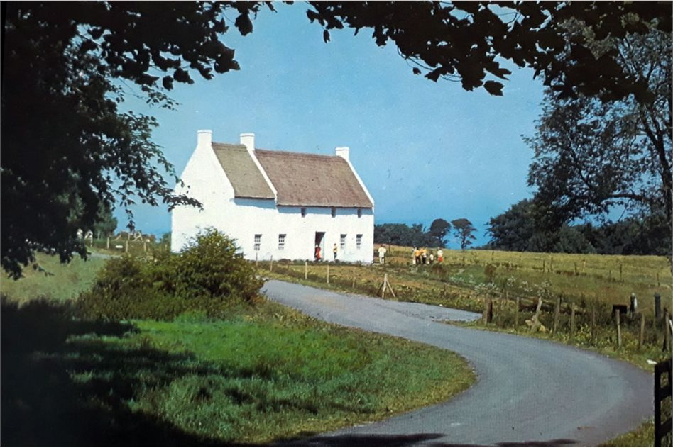 Image: Postcard photograph of the relocated house at the Ulster Folk Museum in the 1970s.