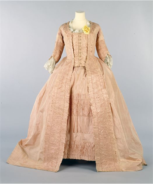 Image: Peach silk open robe, petticoat and stomacher with button trim, 1770s - purchased 1985. BELUM.T2410 © National Museums Northern Ireland