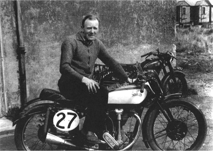 Image: Dick Chamberlain sitting on a Norton that belonged to a friend of his. The motorbike in the background is Dick's (KJ 8262, probably a Norton) that he rode in the Hurst Cup Trial of the same year (1948).
