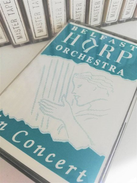 Image: HOYFM.C1992.5 A cassette of the Belfast Harp Orchestra in concert. © Aileen McEwen