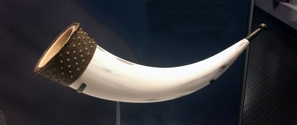Image: Drinking horn  - the body of the horn is a modern reconstruction but originally it is likely to have been a cow horn with the metal fittings attached at either end. BELUM.A8.1991 © National Museums Northern Ireland
