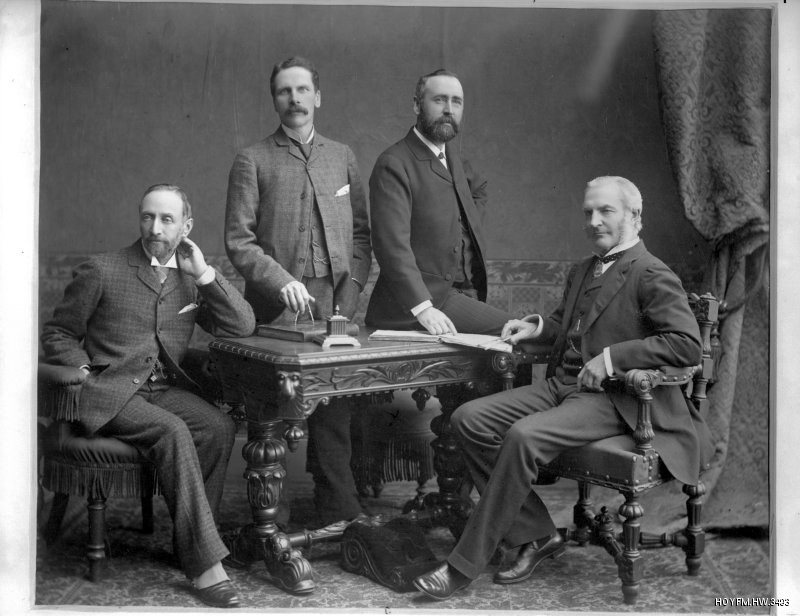 Image: The powerful men who built up Harland & Wolff: (left to right) Gustav Wolff, W.H. Wilson, William J. Pirrie and Edward Harland. William Pirrie's energy and business acumen ensured that the firm prospered in the early years of the twentieth century. HOYFM.HW.3493 © Harland & Wolff Collection, National Museums NI