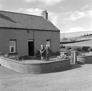 Coleraine Cranagh Farm Mr and Mrs Kennedy in Front of Their Home