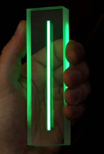 Low-energy radiation from the tritium in this tube causes the luminescent 'phosphor' coating to glow green.