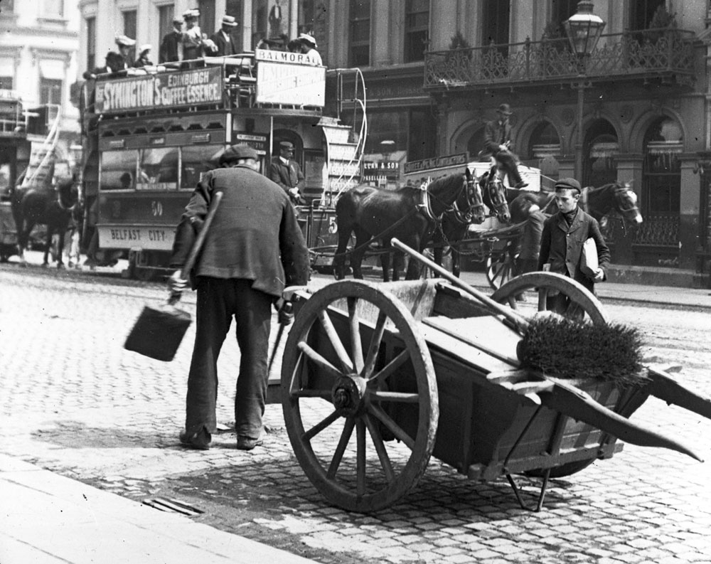 Sweeping up behind the horse-drawn trams, Belfast. BELUM.Y8564 © National Museums Northern Ireland