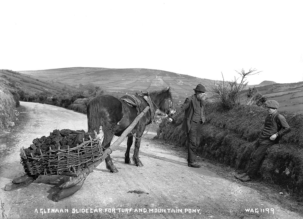 A mountain pony and slide car laden with turf, Glenaan, County Antrim. HOYFM.WAG.1199 © National Museums Northern Ireland