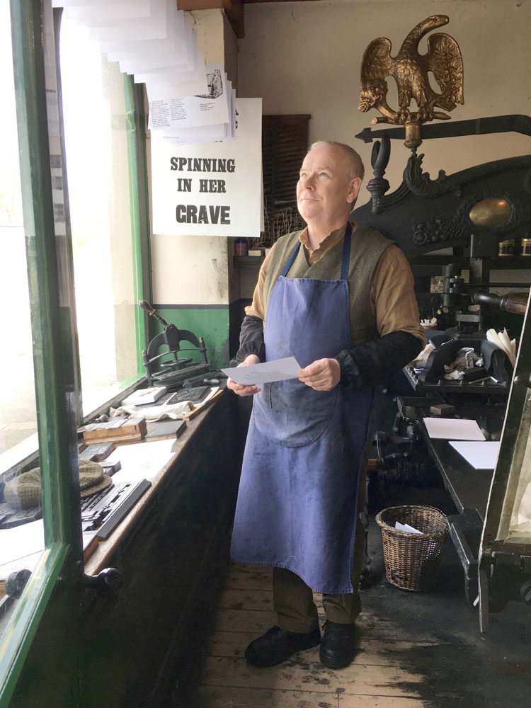The printer at W & G Baird print workshop. © National Museums Northern Ireland