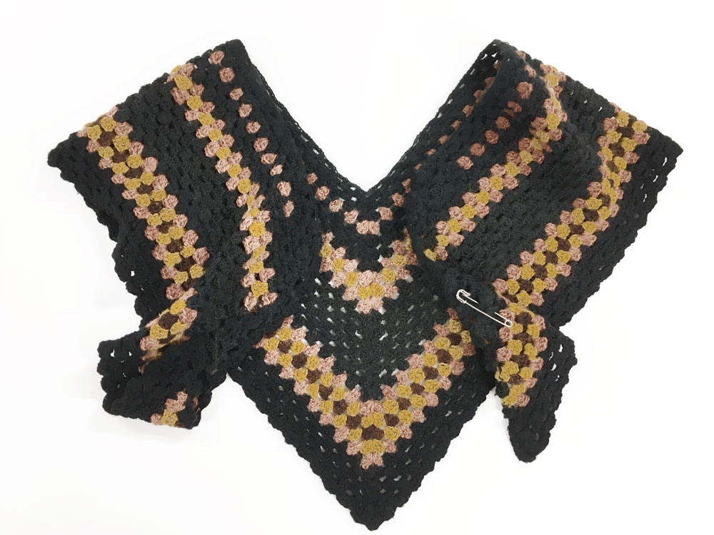 A crochet shawl, a close copy on an original 'hug me tight' style in the museum collection. © National Museums Northern Ireland