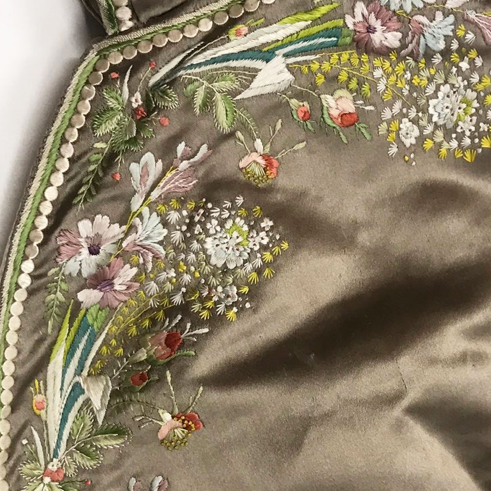 Fine embroidery detail. BELUM.T1830 © National Museums Northern Ireland